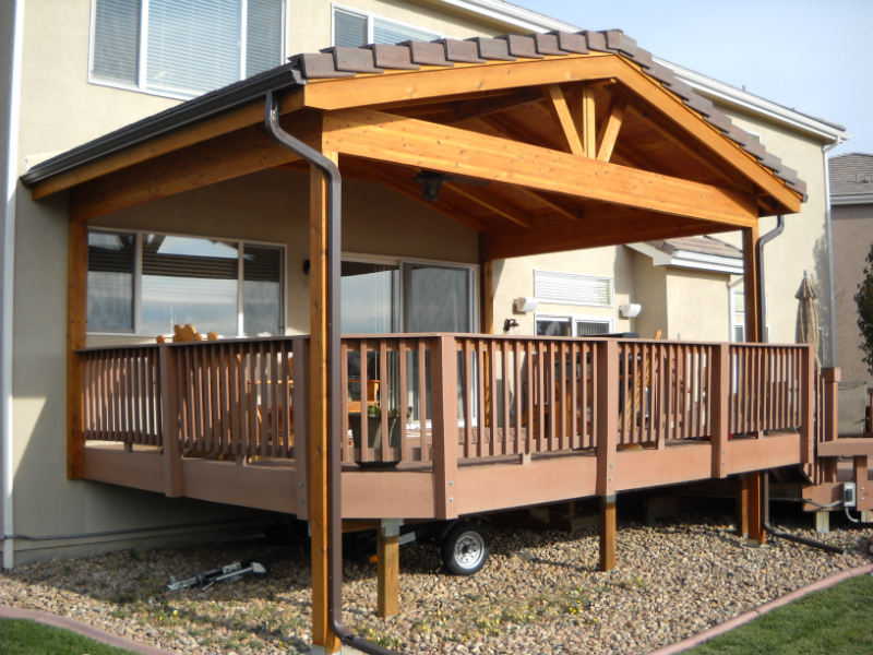 Roof covers protect your deck in the winter decktec for Balcony roof ideas